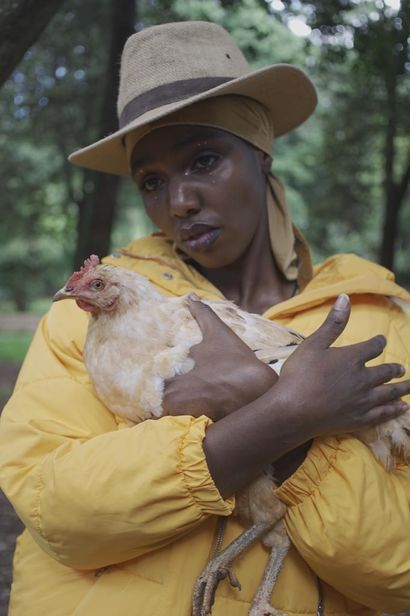 Bakhita with Chicken - a Photographic Art Artowrk by Nyokabi kimari